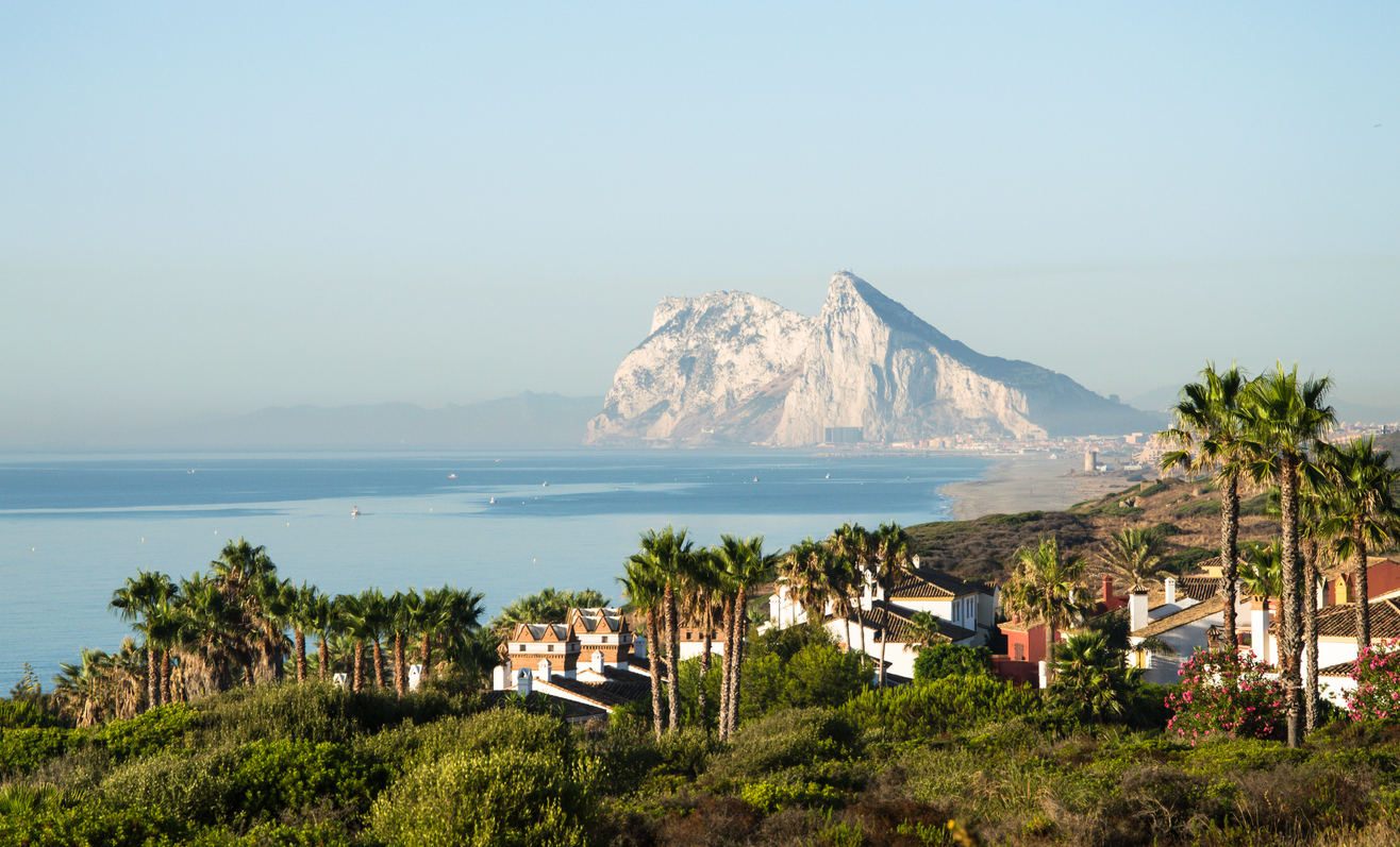 Alcaidesa urbanization in the foreground. Panorama of Straits of Gibraltar. Summer day morning. British overseas territory. Mediterranean sea.